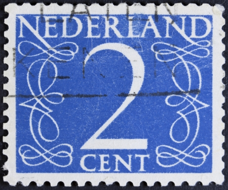 NETHERLANDS - CIRCA 1946  A stamp printed in the Netherlands showing it s value of 2 cent, circa 1946
