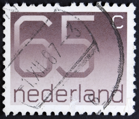 five cents: NETHERLANDS - CIRCA 1982  A stamp printed in the Netherland with a value of sixt five cents, printed ca 1982