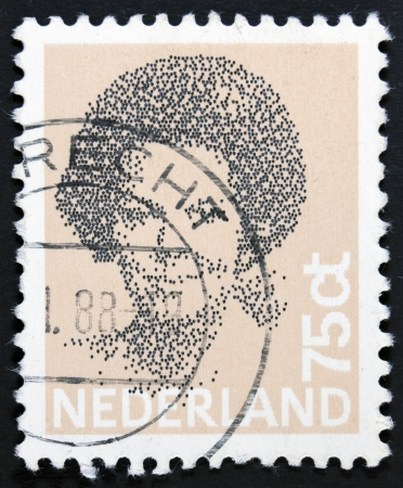 regnant: NETHERLANDS - CIRCA 1982  A stamp printed in Netherlands shows portrait of Queen Beatrix regnant of the Kingdom of the Netherlands, circa 1982  Stock Photo