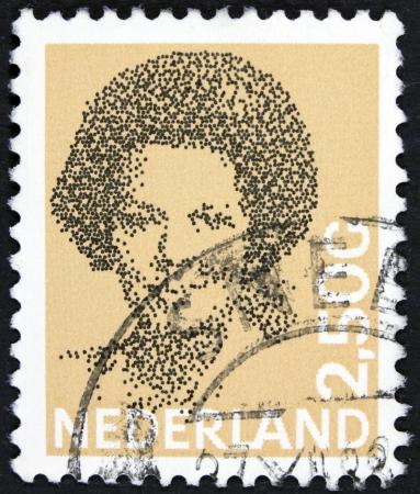 beatrix: NETHERLANDS - CIRCA 1982  A stamp printed in Netherlands shows portrait of Queen Beatrix regnant of the Kingdom of the Netherlands, circa 1982  Stock Photo