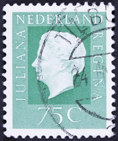regina: NETHERLANDS - CIRCA 1969  A stamp printed in Netherlands shows portrait of Queen regnant of Netherlands Juliana with the inscription  Juliana regina , from the series  Queen Juliana , circa 1969