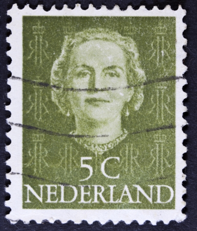 regina: NETHERLANDS - CIRCA 1949  A stamp printed in Netherlands, shows portrait of Queen Whilhelmina, monogram and a crown without inscription, from the series  Queen Whilhelmina , circa 1949  Stock Photo