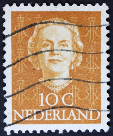 NETHERLANDS - CIRCA 1949  A stamp printed in Netherlands, shows portrait of Queen Whilhelmina, monogram and a crown without inscription, from the series  Queen Whilhelmina , circa 1949  photo
