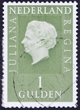 juliana: NETHERLANDS - CIRCA 1971  A stamp printed in Netherlands shows portrait of Queen Juliana  1909-2004  was the Queen regnant of the Kingdom of the Netherlands, circa 1971