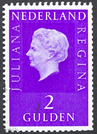 regnant: NETHERLANDS - CIRCA 1971  A stamp printed in Netherlands shows portrait of Queen Juliana  1909-2004  was the Queen regnant of the Kingdom of the Netherlands, circa 1971
