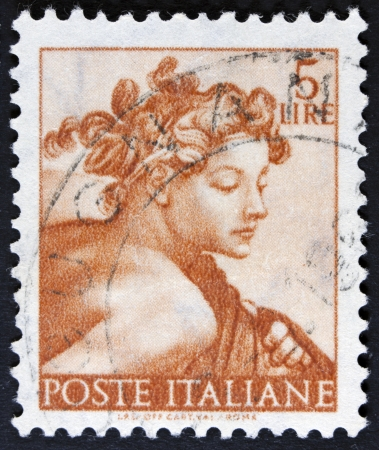 philately: ITALY - CIRCA 1961  A stamp printed in Italy shows a head of the  Isaiah   Michelangio , without inscription, from the series  Frescoes in the Sistine Chapel , circa 1961  Stock Photo
