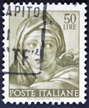 sibyl: ITALY - CIRCA 1961 A stamp printed in Italy shows a head of the Delphic Sibyl  Michelangio , without inscription, from the series Frescoes in the Sistine Chapel, circa 1961  Stock Photo
