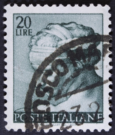 chapel: ITALY - CIRCA 1961 A stamp printed in Italy shows a head of the Delphic Sibyl  Michelangio , without inscription, from the series Frescoes in the Sistine Chapel, circa 1961  Stock Photo