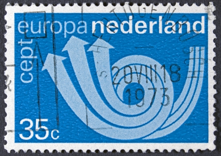 posthorn: NETHERLANDS - CIRCA 1973  A stamp printed in Netherlands shows postal triple horn symbolizing post, telegraph and telephone, circa 1973