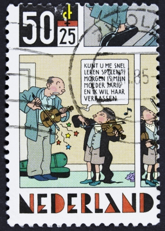 strip a dog: NETHERLANDS - CIRCA 1984 A stamp printed in Netherlands shows Strip Cartoons -The king and money chest, circa 1984