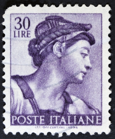 sibyl: ITALY - CIRCA 1961 A stamp printed in Italy shows a head of the Sibyl Eritrea  Michelangio , without inscription, from the series Frescoes in the Sistine Chapel, circa 1961  Stock Photo