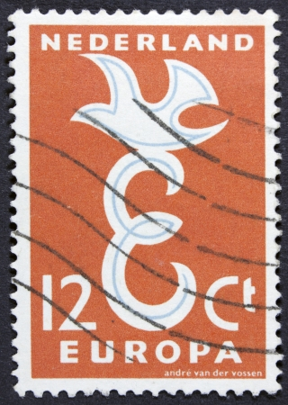 HOLLAND - CIRCA 1960  Stamp printed in the Netherlands shows Hollands connection with Europe, circa 1960  photo