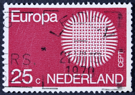 nederlan: NETHERLANDS - CIRCA 1970  A stamp printed in Netherlands shows symbolic sun and the word CEPT, circa 1970  Stock Photo