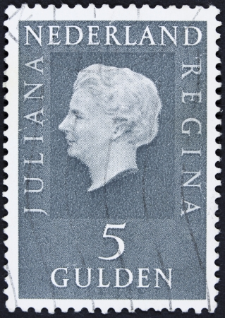 regina: NETHERLANDS - CIRCA 1971  A stamp printed in Netherlands shows portrait of Queen Juliana  1909-2004  was the Queen regnant of the Kingdom of the Netherlands, circa 1971