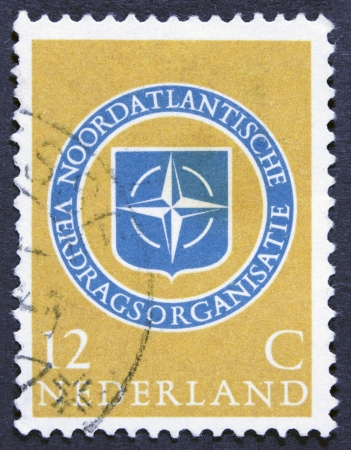 nato: NETHERLANDS - CIRCA 1959  a stamp printed in the Netherlands shows NATO Emblem, 10th Anniversary of NATO, circa 1959