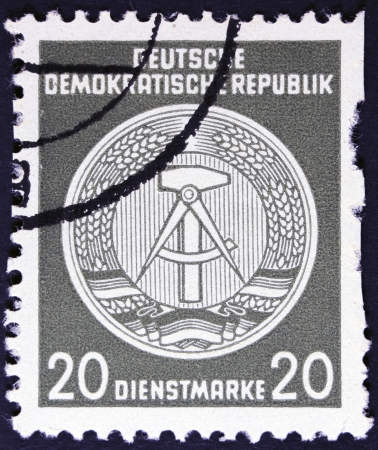 east of germany: DDR - CIRCA 1952  A Stamp printed in GDR  German Democratic Republic - East Germany  shows DDR national coat of arms with inscription  Service Stamp , series  GDRs national coat of arms , circa 1952  Stock Photo