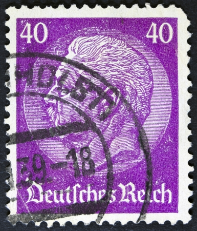 hindenburg: GERMANY - CIRCA 1933  A stamp printed in Germany shows portrait of Paul von Hindenburg  2nd President of German Reich , without inscription, from series  85th birthday of von Hindenburg , circa 1933