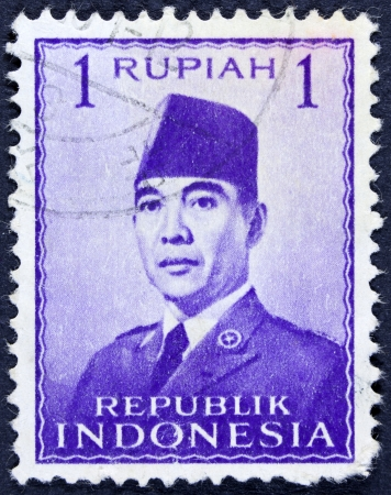 sukarno: INDONESIA - CIRCA 1951  A stamp printed in the Indonesia shows the first president of Indonesia Sukarno, circa 1951  Editorial