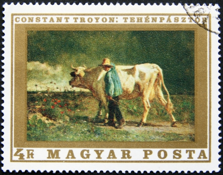magyar posta: HUNGARY   CIRCA 1975  postage stamp printed in Hungary A farmer with his cow on land, circa 1975  Stock Photo