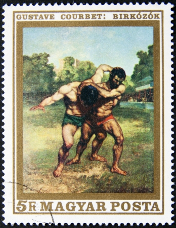 magyar posta: HUNGARY  CIRCA 1975  postage stamp printed in Hungary Two men wrestling, circa 1975  Stock Photo