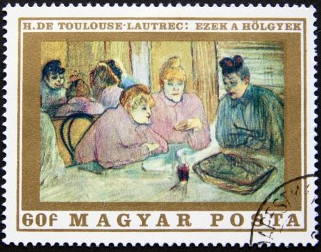 HONGARIJE CIRCA 1975 postzegel gedrukt in Hongarije Een woonkamer met mensen aan de tafel, circa 1975