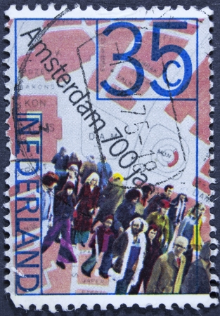 dam square: NETHERLANDS - CIRCA 1975  A stamp printed in Netherlands shows People and Map of Dam Square, 700th anniversary of Amsterdam, circa 1975