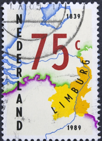 limburg: NETHERLANDS - CIRCA 1989  A stamp shows map of the Dutch province of Limburg and value 75 cents, circa 1989  Stock Photo