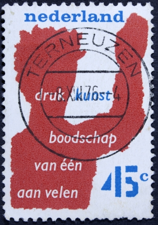 NETHERLANDS - CIRCA 1976  a stamp printed in the Netherlands shows Printing, One Communicating with Many, Anniversary of Netherlands Printers Organization, circa 1976  photo