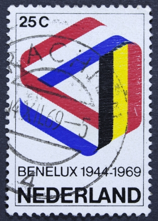 benelux: NETHERLANDS - CIRCA 1969  a stamp printed in the Netherlands shows Mobius Strip in Benelux Colors, 25th Anniversary of the Signing of the Customs Union, circa 1969  Stock Photo