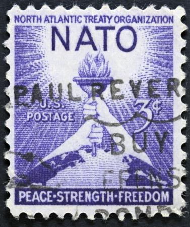 north atlantic treaty organization: USA - CIRCA 1952 A stamp printed in the USA shows North Atlantic Treaty Organization NATO, Peace, Strenght, Freedom, circa 1952  Stock Photo