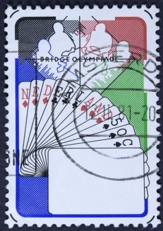 olympiad: NETHERLANDS - CIRCA 1980  a stamp printed in the Netherlands shows Bridge Players, Netherlands Hand, 6th Bridge Olympiad, Valkenburg, circa 1980
