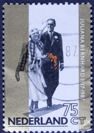 HOLLAND -CIRCA 1987  Stamp printed in the Netherlands for the golden jubilee of the wedding of Queen Juliana with Prince Bernhard von Lippe Biesterfeld in 1937, circa 1987  Stock Photo - 23705783