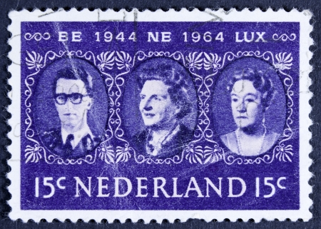 benelux: NETHERLANDS - CIRCA 1964  a stamp printed in the Netherlands shows King Baudouin, Queen Juliana and Grand Duchess Charlotte, Benelux, circa 1964  Editorial