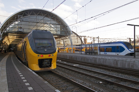 Just arrived train on the central station of Amsterdam