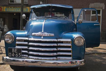MEDEMBLIK, THE NETHERLANDS - JULY 27,2014: Front view of a Blue Chevrolet pick up 1952 on a oldtimer show on july 27,2014 in Medemblik.