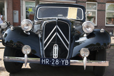 avant: MEDEMBLIK, THE NETHERLANDS - JULY 27,2014: Front view of a France Citroen traction avant on a oldtimer show on july 27,2014 in Medemblik Editorial