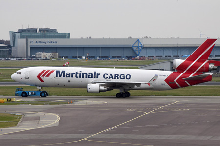 just arrived: Amsterdam,Holland -23 February, 2014: Just arrived martinair cargo aircraft ready to be unloaded on shiphol national airporr. Editorial