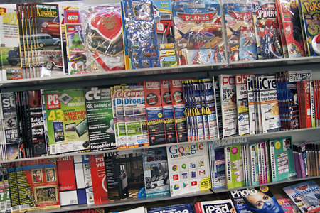 HOORN, THE NETHERLAND - DECEMBER 20,2014: Serveral different colorful magazines in a bookstore
