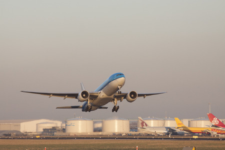 ascended: Amsterdam the Netherlands 18 february 2015: Just the runway ascended klm plane at the airport of Schiphol with a low standing sun Editorial