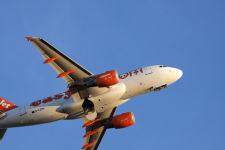 ascended: Amsterdam the Netherlands 18 february 2015: Flying just ascended commercial aircraft from easyJet on a blue sky to his destination with passengers. Editorial