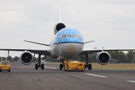 klm: Gilze-Rijen, The Netherlands - June 21, 2014: klm plane parked on the runway after landing Editorial