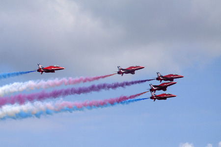 royal air force: Gilze-Rijen, The Netherlands - June 21, 2014: Team the red arrows falling on the royal air force days. Editorial