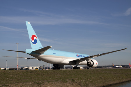 reloaded: AMSTERDAM, THE NETHERLANDS - March 11, 2015: Back of an Korean cargo Boeing 777-300 ER just landed at Schiphol and will be reloaded On March 11, 2015 in Amsterdam, Holland.