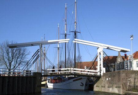 enkhuizen: Old white wooden bridge in the center of the Dutch city Enkhuizen Stock Photo