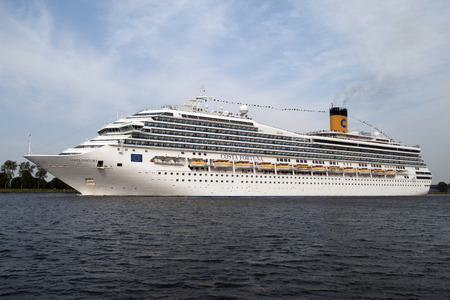 ijmuiden: Port of Ijmuiden, Noord-Holland, Netherlands - August 23, 2015: Cruise ship Costa Fortuna sails from the port of IJmuiden to the north sea
