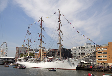historic world event: AMSTERDAM, THE NETHERLANDS, 20 AUGUST 2015: Large white tall ship in the port of Amsterdam falling on the great nautical event SAIL 2015
