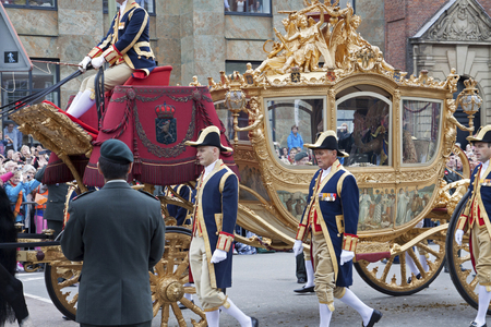 carriages: THE HAGUE, HOLLAND - SEPT 16: Queen Maxima waving in golden carriage waving to crowds on Budget Day opening parliamentary year by King