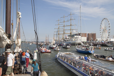historic world event: AMSTERDAM, THE NETHERLANDS, 20 AUGUST 2015: People enjoy from the boat of all ships and tall ships falling on the great nautical event SAIL 2015