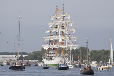 gloria: Port of Amsterdam, Noord-Holland, Netherlands - August 19, 2015: Sailors on the masts of the tall ship Arc Gloria from Colombia constantly sail in 2015