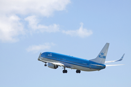 ascended: AMSTERDAM, THE NETHERLANDS - SEPTEMBER 30, 2015: Of the runway ascended boeing 737 klm route to his destination on a sunny day